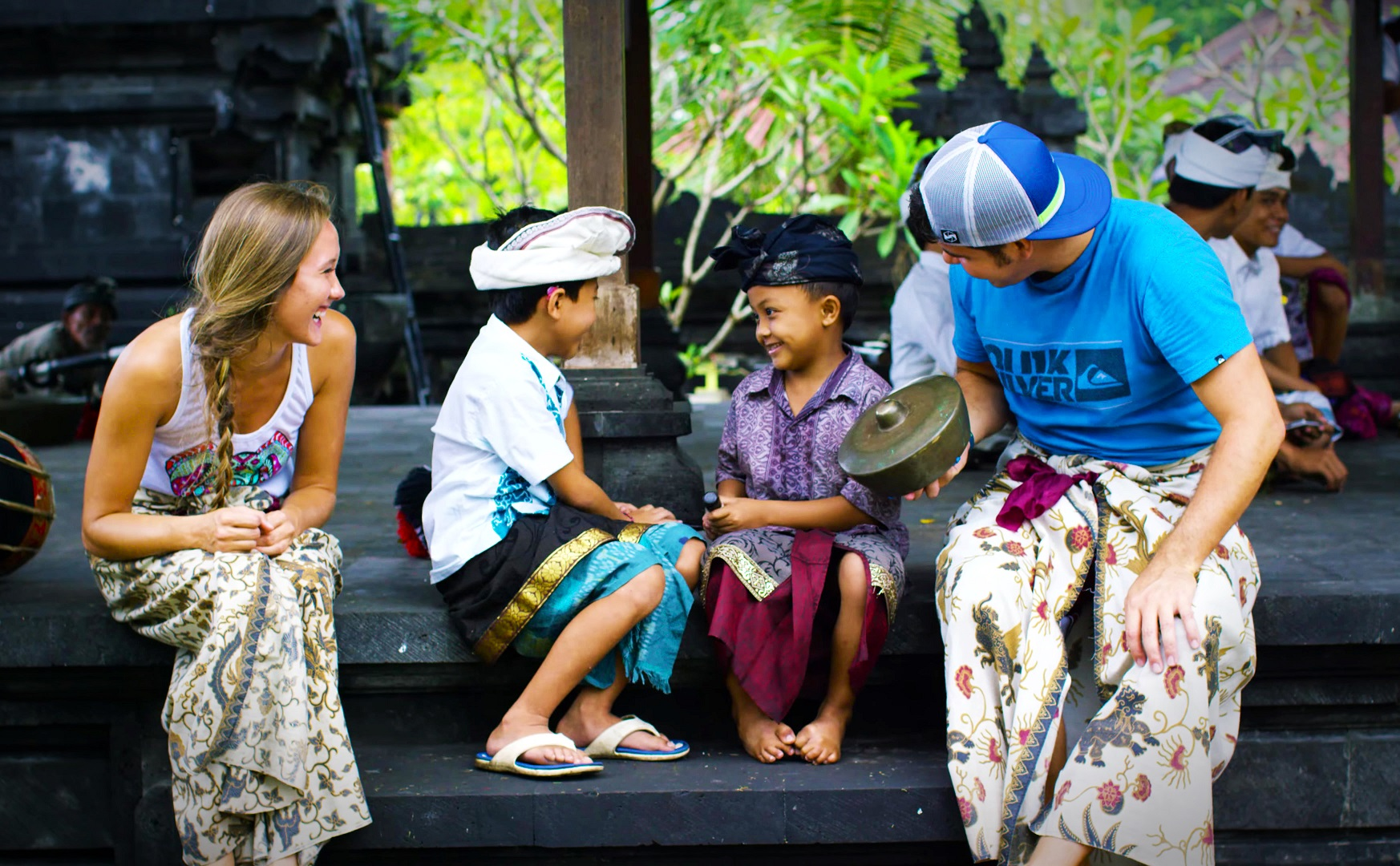 taking part in local residents activities in balinese village