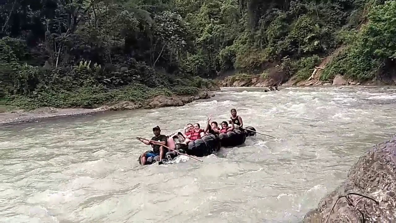 tubing in the river of bukit lawang
