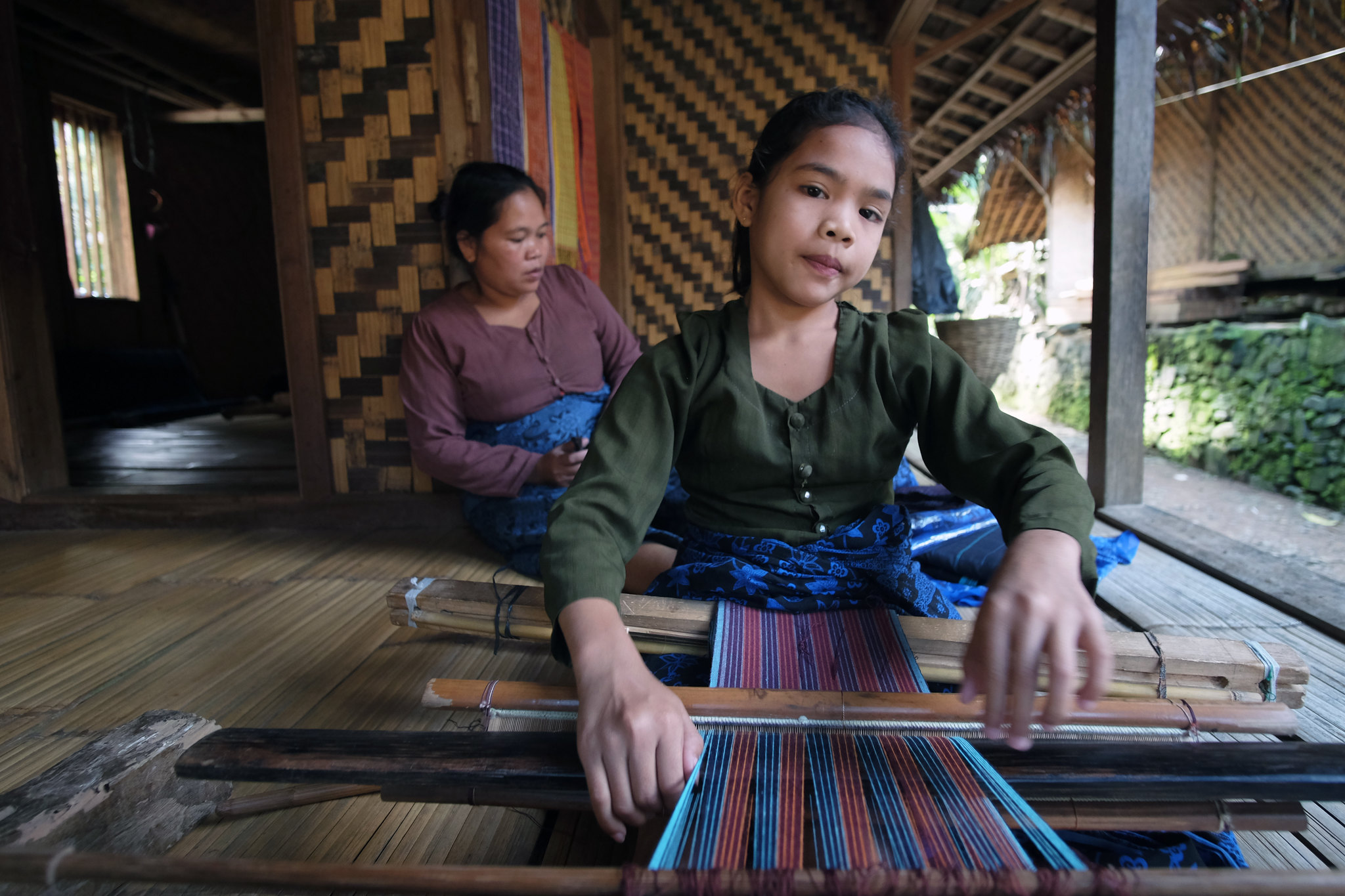 baduy woman weaving activity