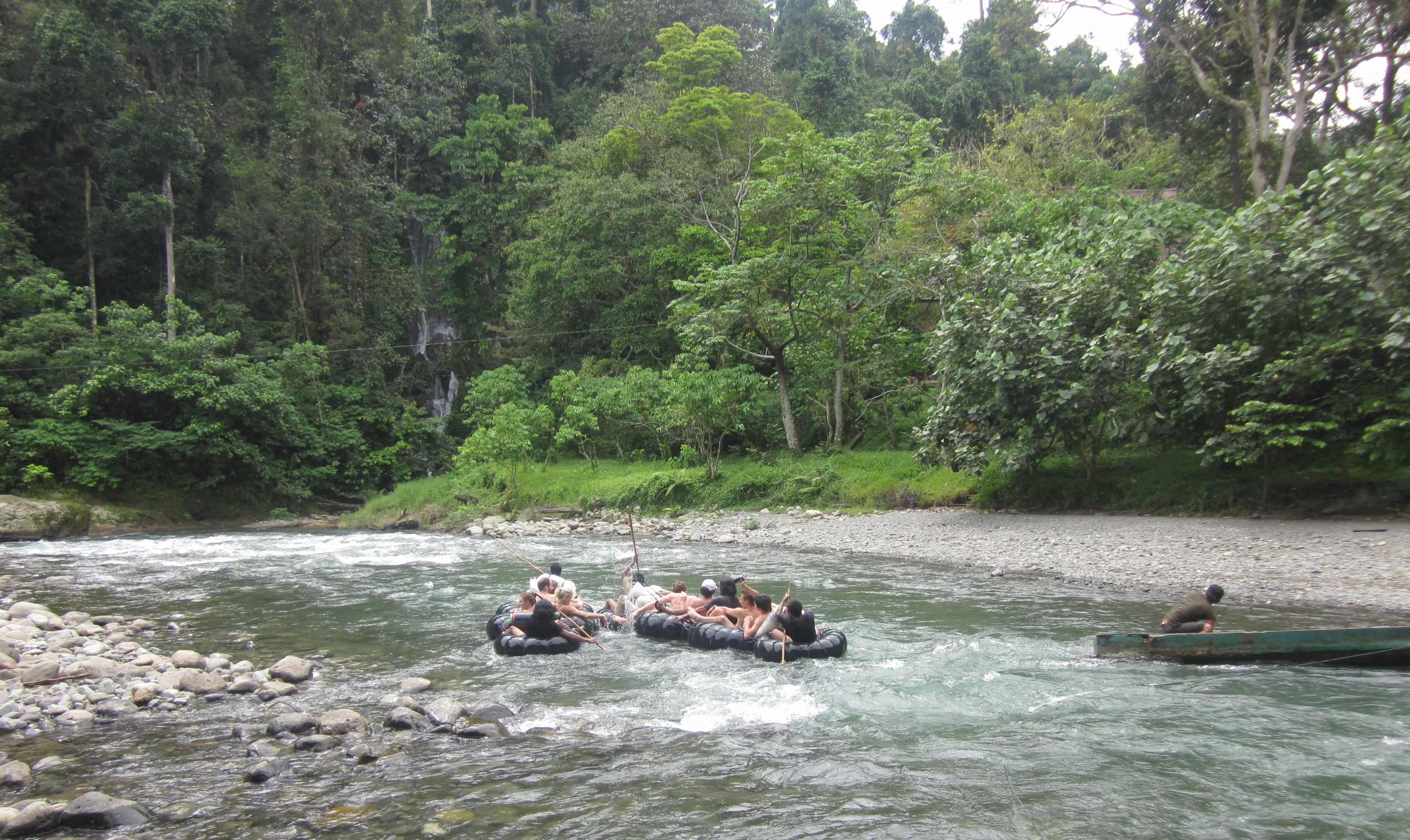 cruising the rushing river of tangkahan